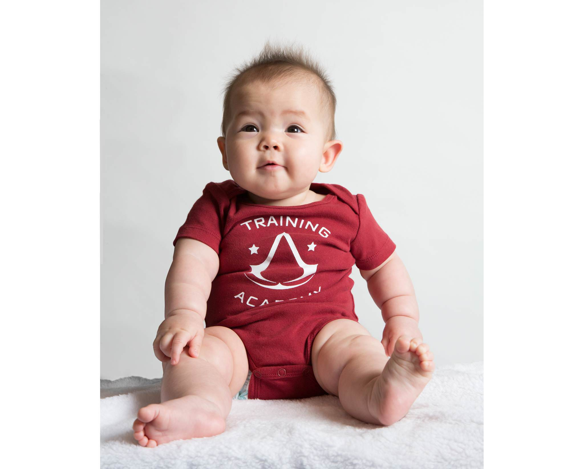 fad83b798b2d Assassin s Creed Baby Collection - Training Academy Red Onesie